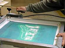 Mount the screen onto the screen printing press
